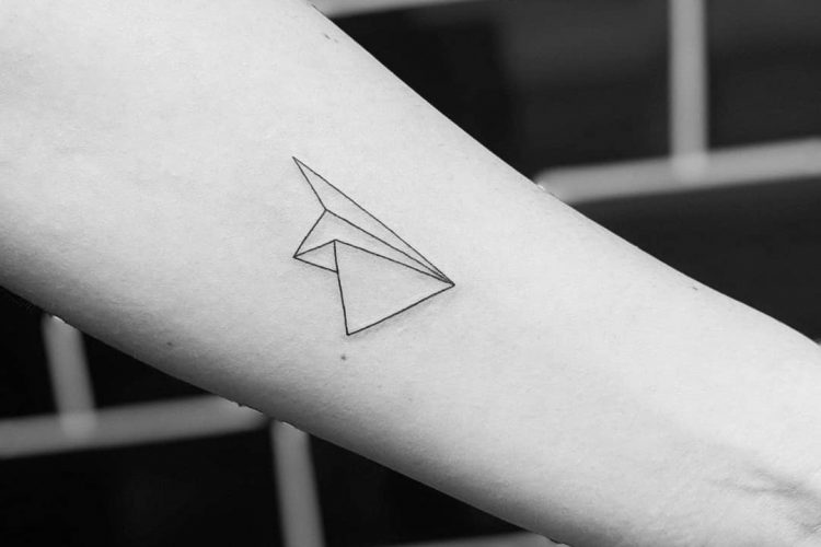 Paper airplane tattoo